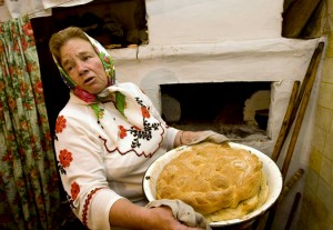A woman in Belarus national dress prepares bread to take part in the pagan rite Yurya celebration, a harvest protector, in the village of Pogost